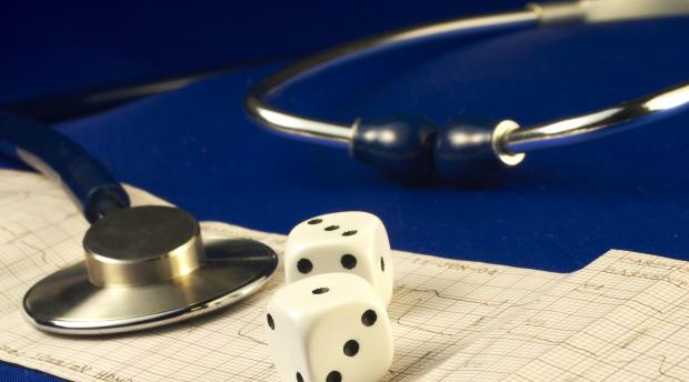 Risk Pic  with Dice and stethoscope